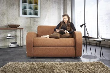 JAYBE CHAIR BED Retro Chair - Sofa Front On with Model at Just British Sofas