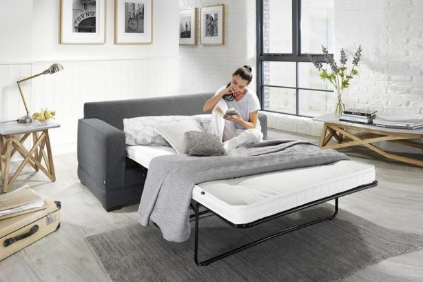 JAYBE-MODERN-SOFA-Modern-Pocket-Bed-from-Angle-Dressed-with-Model-at-Just-British-Sofas 2018