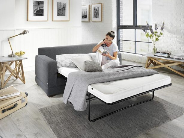 JAYBE MODERN SOFA - Modern-Pocket-Bed-from-Angle-Dressed-with-Model at Just British Sofas
