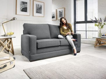 JAYBE MODERN SOFA – Modern Pocket – Sofa from Angle with Model at Just British Sofas
