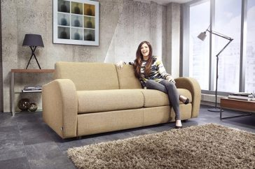 JAYBE Retro 3 Seater - Sofa From Angle with Model at Just British Sofas