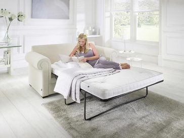 JAYBE SOFA BED Classic Pocket - Bed from Angle with Model at Just British Sofas the sofa bed experts