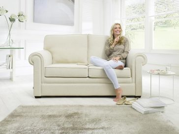 JAYBE SOFA BED Classic Pocket – Sofa Front On with Model at Just British Sofas the sofa bed experts