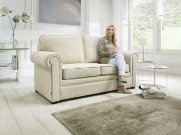 JAYBE SOFA BED Classic Pocket – Sofa from Angle with Model at Just British Sofas the sofa bed experts