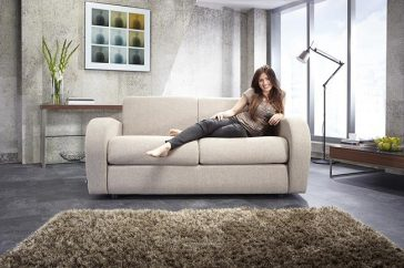 JAYBE SOFA BED Retro 2 Seater – Sofa Front On with Model at Just British Sofas