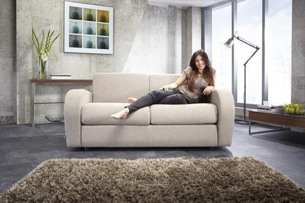 JAYBE SOFA BED Retro 2 Seater - Sofa Front On with Model at Just British Sofas