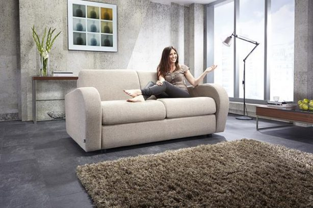 JAYBE SOFA BED Retro 2 Seater - Sofa from Angle with Model at Just British Sofas